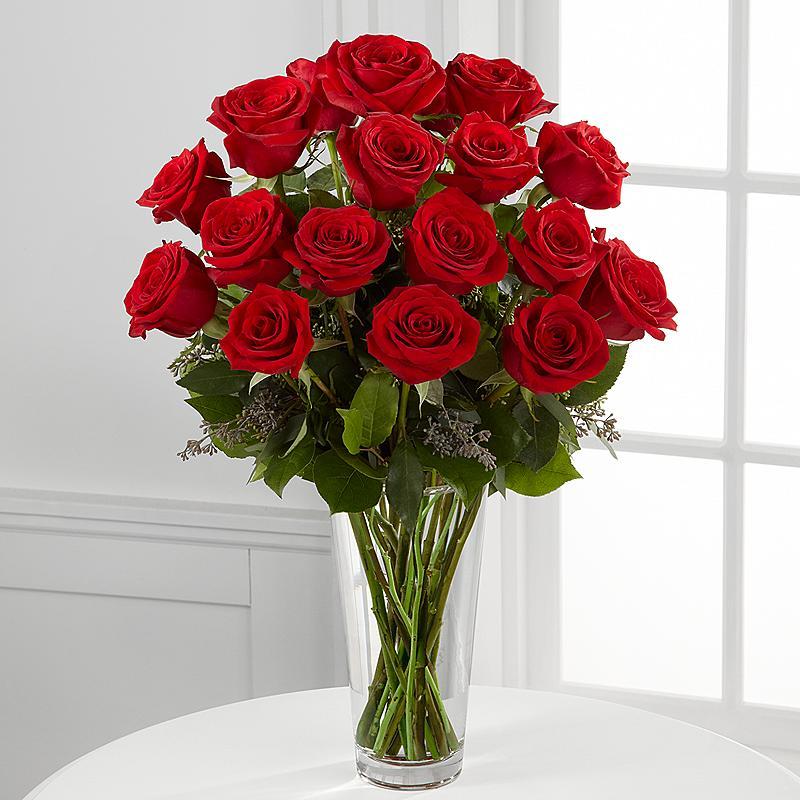 Vase avec douzaine de roses